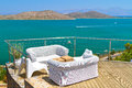 White sofas at Mirabello Bay on Crete Royalty Free Stock Photos