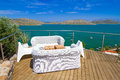 White sofas with mirabello bay view on crete Royalty Free Stock Photography