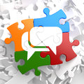 White speech bubble icon on multicolor puzzle communication concept Royalty Free Stock Image