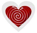 White spiral in red heart on a gray background Stock Image