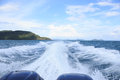 White splash wave water surface behind fast motor speed boat Royalty Free Stock Photo