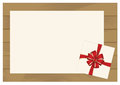 White Square Gift Box with Red Bow on Wooden Plank Background with White sheet of paper.