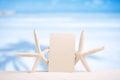 White starfish with blank retro photo on white sand beach, sky a Royalty Free Stock Photo