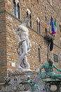 White statue of Neptune in the fountain in Florence Royalty Free Stock Photo