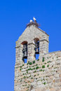 White stork nest with the couple on it on top of the belfry of the flor da rosa monastery belonged to hospitaller knights aka Royalty Free Stock Photo