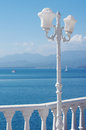 White street figured lamp against the sea in a summer sunny day Royalty Free Stock Photos