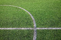 White stripe line on the artificial green grass field Royalty Free Stock Image