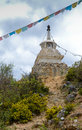 White stupa and praying flags in shangrila china Stock Photo