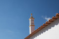 White stylish arabesque chimney on rooftop in blue sky Royalty Free Stock Photo