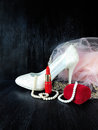 White stylish high heel shoe, pearl jewellery and red lipstick Royalty Free Stock Photo