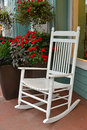 White summer rocker a rocking chair on a afternoon Royalty Free Stock Photo