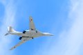 White swan russian military aircraft supersonic bomber moscow may with variable sweep wing tu in parade flight against blue sky in Stock Images