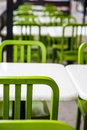 White tables and green chairs rows of with Royalty Free Stock Photos
