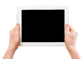 White tablet computer with a black blank screen in the human ha thehuman hands isolated on background Stock Images