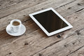 White tablet computer with cup coffe on a wooden table top view copy space free space for text office desk mock up Stock Photo