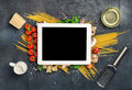White tablet with copy space with Ingredients for cooking pasta Royalty Free Stock Photo