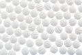 White tablets in abundance symbol photo for medicine remedies and painkillers Stock Images