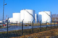 White tank in tank farm with blue Royalty Free Stock Photo