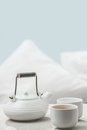 White teapot and cups on table Royalty Free Stock Photo