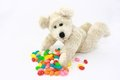 White Teddy Bear With Colorful Candies Stock Photos