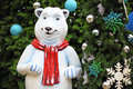 White teddy bear with decorations under the christmas tree Royalty Free Stock Images