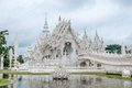 White temple with reflecting pond in thailand Stock Photography