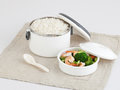 White tiffin carrier with rice and fried shrimps and bloccori Stock Photos