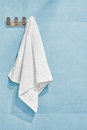 White towel hanging on a wall in bathroom Royalty Free Stock Photo