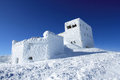 White toy show fort on the uneven snow surface under sun light castle in Royalty Free Stock Image