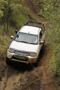 White toyota triton dhd crossing mud obstacle bafokeng march at leroleng x track on march in bafokeng rustenburg south africa Stock Image