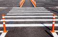 White traffic markings with a pedestrian crossing on gray asphalt parking lot Stock Photos