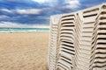 White trestle beds on the beach Stock Photo