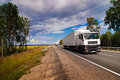 White trucks traveling on the highway Royalty Free Stock Image