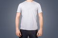 White tshirt on young man template for your design front view isolated background Stock Photo