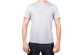 White tshirt on young man template for your design front view isolated background Royalty Free Stock Photo