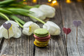 white tulips and macaroons