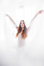 White tulle beautiful girl in a body plays with Stock Photography