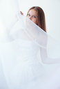 White tulle beautiful girl in a body plays with Stock Images