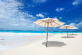 White umbrellas beautiful tropical beach anguilla caribbean Stock Photography