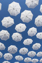 White umbrellas on blue sky ornamental flying in the Royalty Free Stock Image