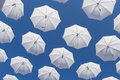 White umbrellas on blue sky ornamental flying in the Royalty Free Stock Photo