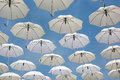 White umbrellas flying in the sky Royalty Free Stock Photo