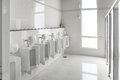 White urinals in clean men public toilet room empty Royalty Free Stock Photo