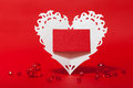 White valentines lace heart with card red paper place for text and glass shiny beads on the red background Stock Image