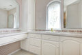 White vanity in soft pink bathroom wooden with arch window Stock Image