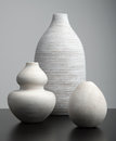 White vases on a dark surface Stock Image