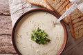 White vegetable cream soup close up in a bowl. horizontal top vi Royalty Free Stock Photo