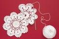 White vintage crochet doily. Cotton yarn for knitting, crochet hook