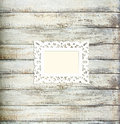 White Vintage picture frame on old wood background Royalty Free Stock Photo