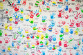 White wall with colorful imprints of children hands. Royalty Free Stock Photo